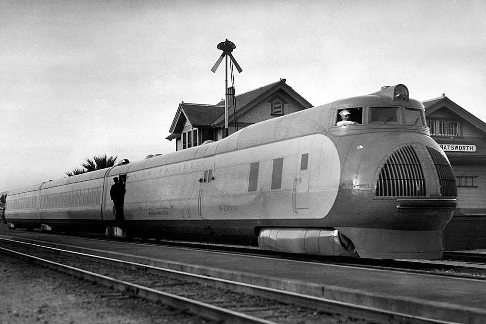 Streamlined passenger train stopped at station