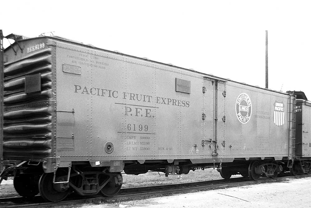 Three-quarter view of steel-constructed refrigerator rail car