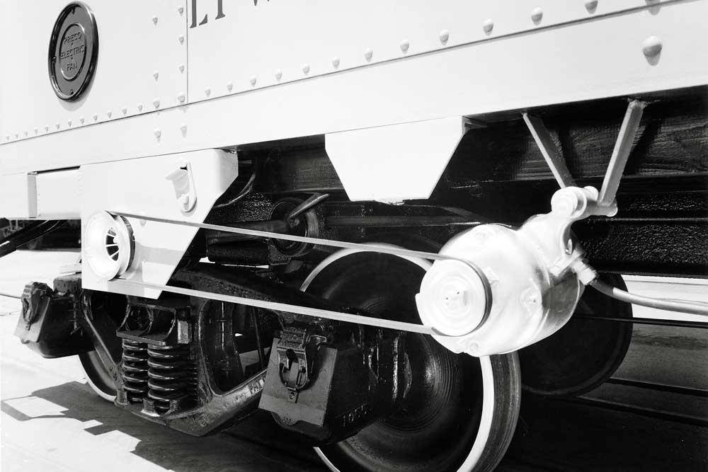 Freight car generator attachment