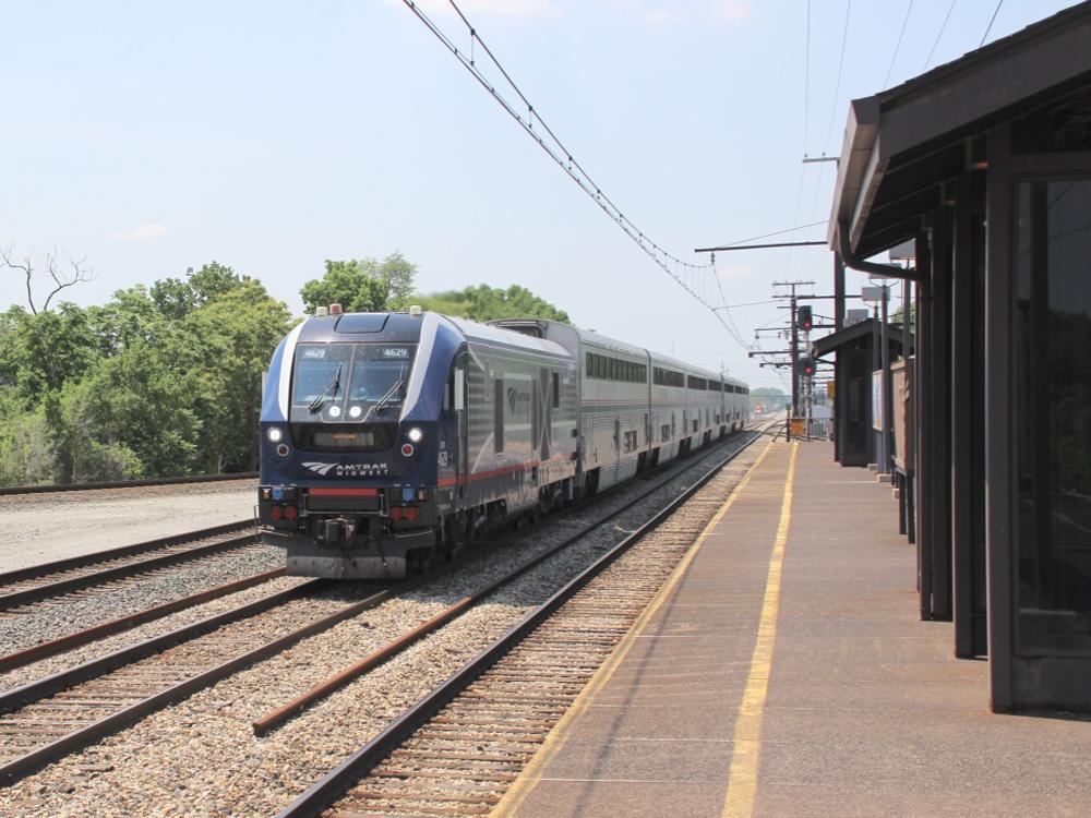 Passenger train passes station
