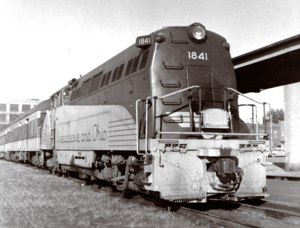 Rear of diesel locomotive along station platform canopy