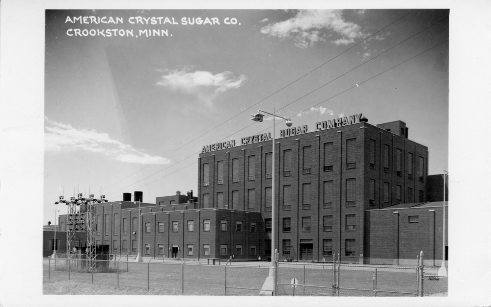 Black-and-white real photo postcard of American Crystal Sugar Co. factory in Crookston, Minn.
