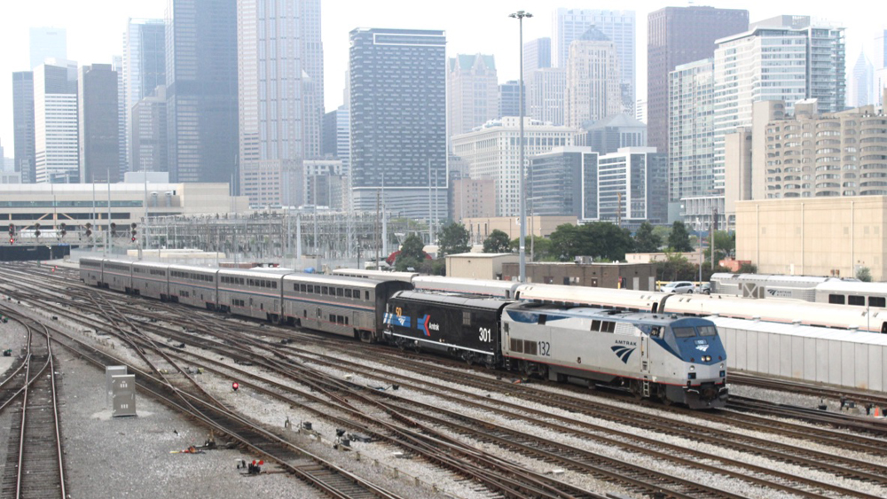 Train with two Amtrak locomotives, second in special black paint scheme