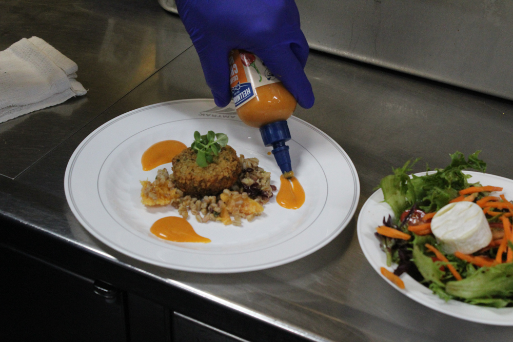Sauce added to plate in decorative fashion