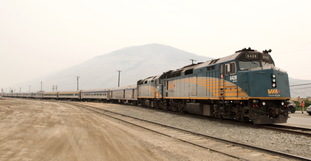 Parked passenger train under smoky skies