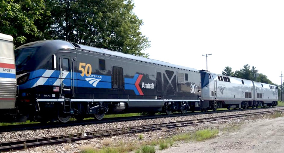 Black locomotive with red and blue arrow