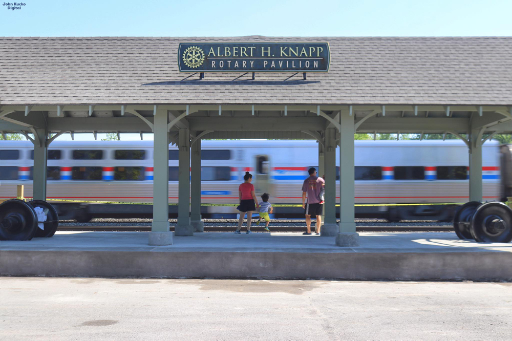 Railfan viewing platform with Amtrak train passing in background