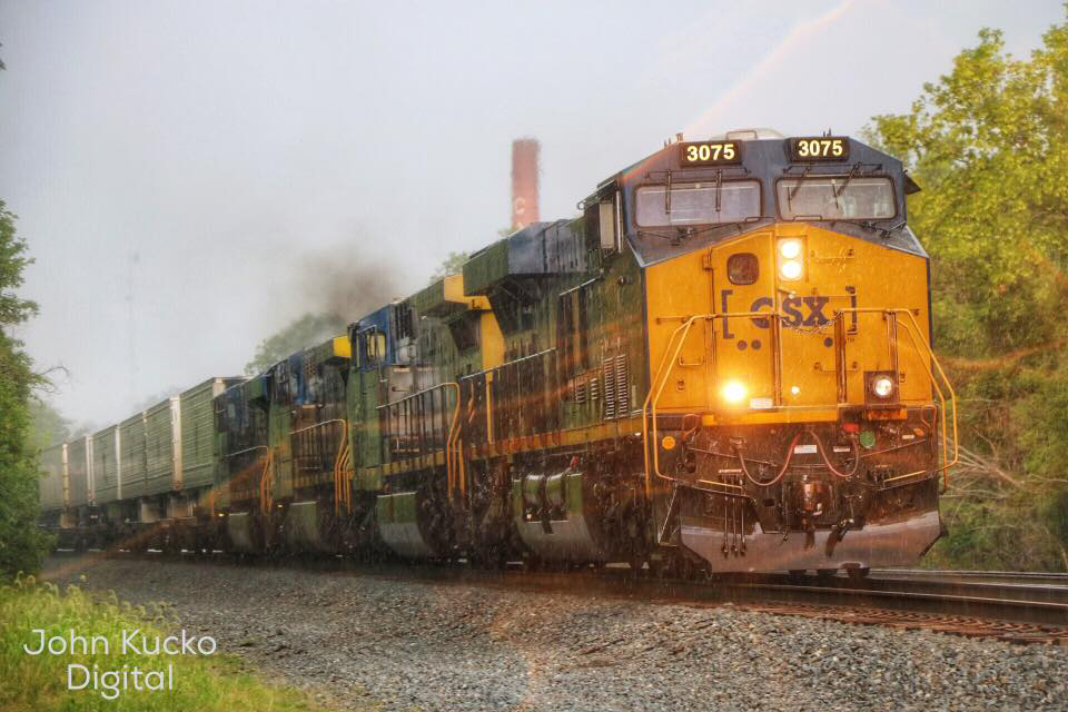 Freight train approaches during storm