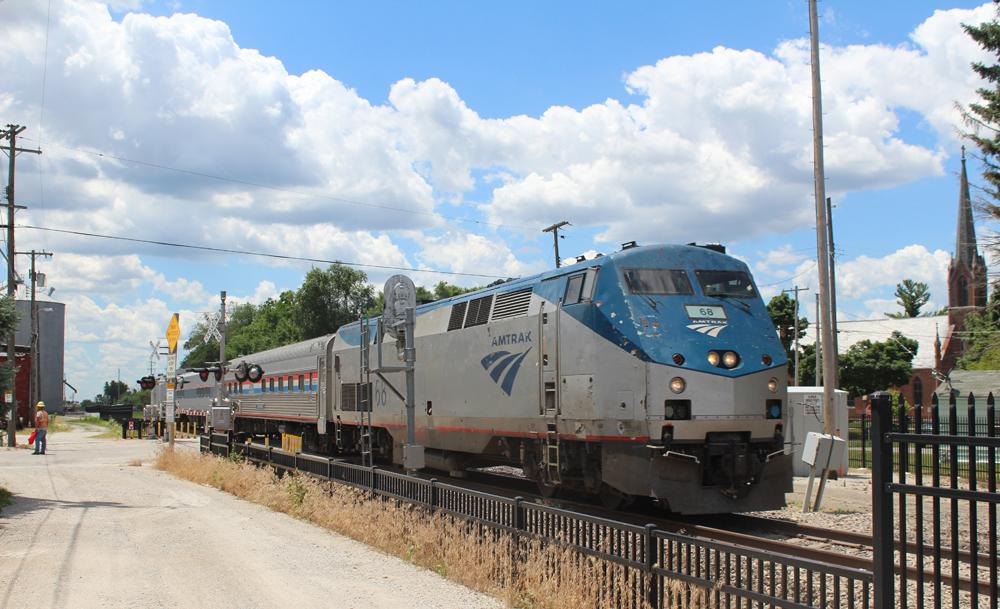 Passenger train passes signals