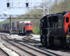 Electrified commuter train meets two freight trains