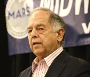 man in suit speaking