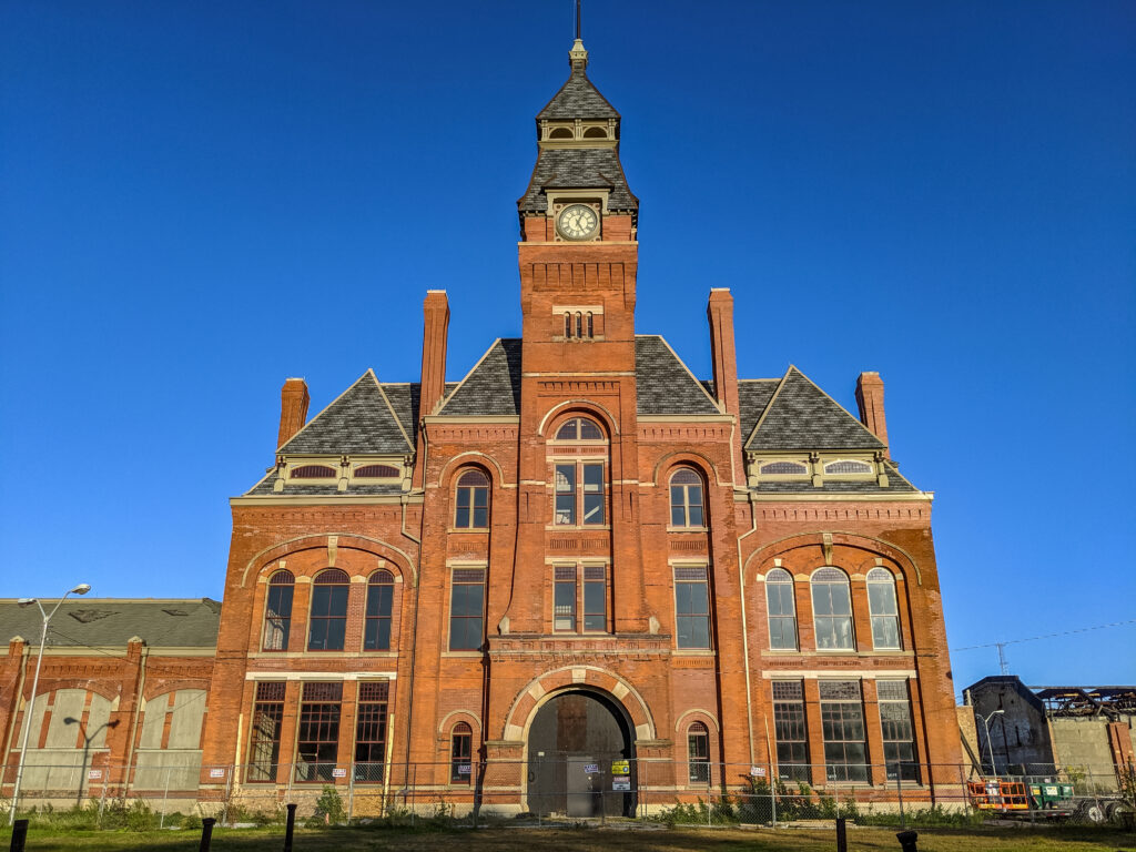 Ornate multistory brick building with clock tower
