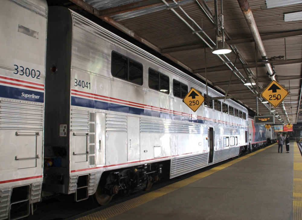 Bilevel stainless steel car at station platform