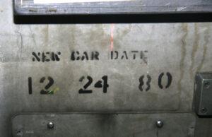 Numbers 12-24-80 painted on sheet metal