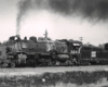 Black-and-white view of 2-8-2 steam locomotive