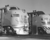 Black-and-white view of the noses of two streamlined diesel locomotives