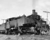 Black-and-white three-quarter view of 2-6-6-2 steam locomotive