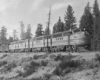 Black-and-white view of four-unit streamlined diesel locomotive