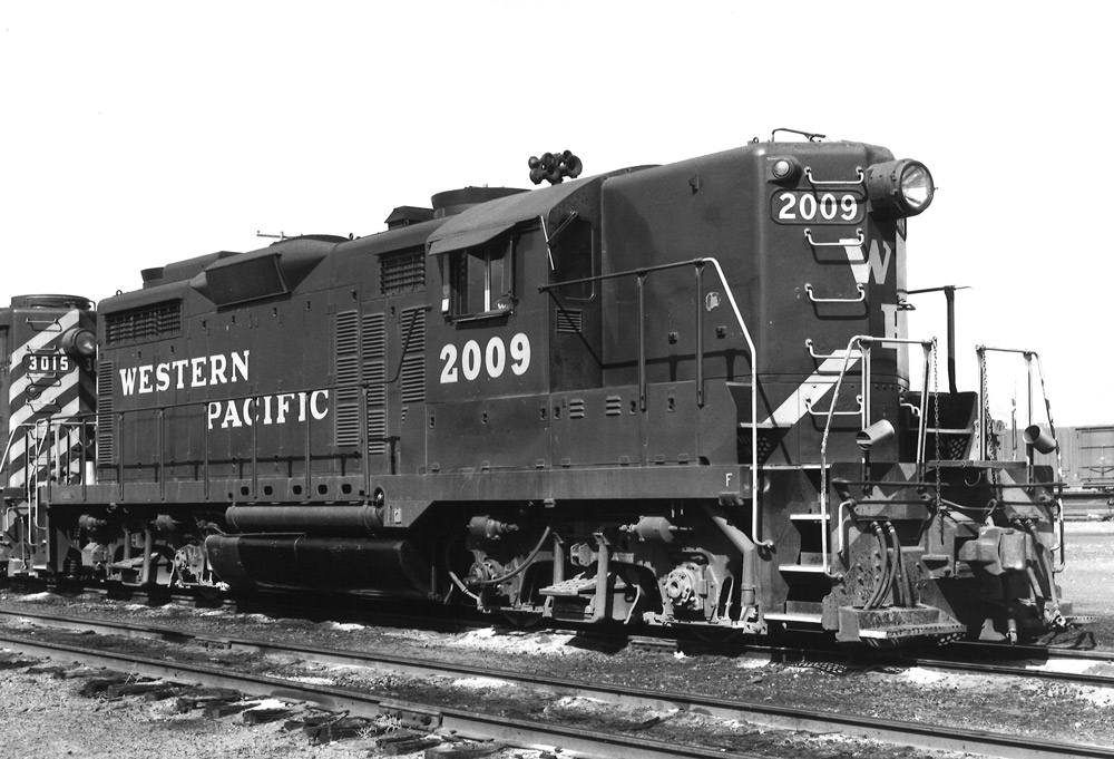 Black-and-white view of diesel road-switcher locomotive