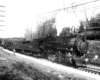 Three steam locomotives led by an 0-8-0 switcher on an incline in a black-and-white image.