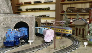 Three toy train engines on a layout