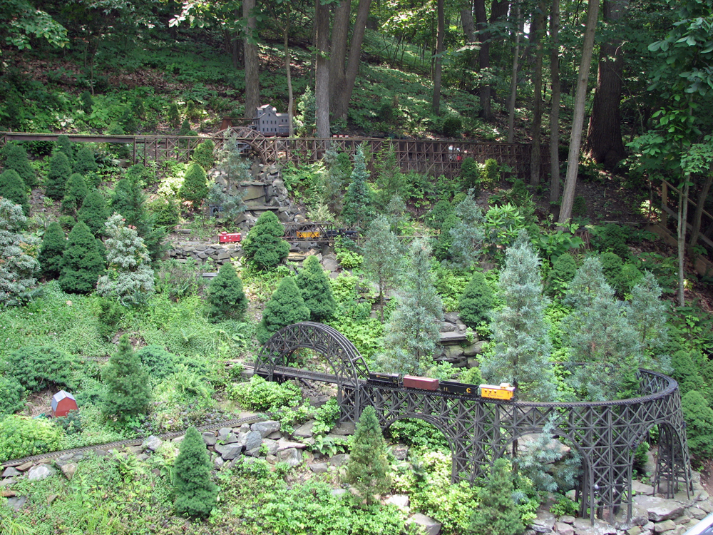 A garden railway built on a slope with trestles