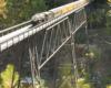 Model train on a high trestle