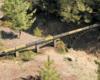 Model passenger train on bridge