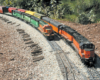 Two model freight trains on a curve