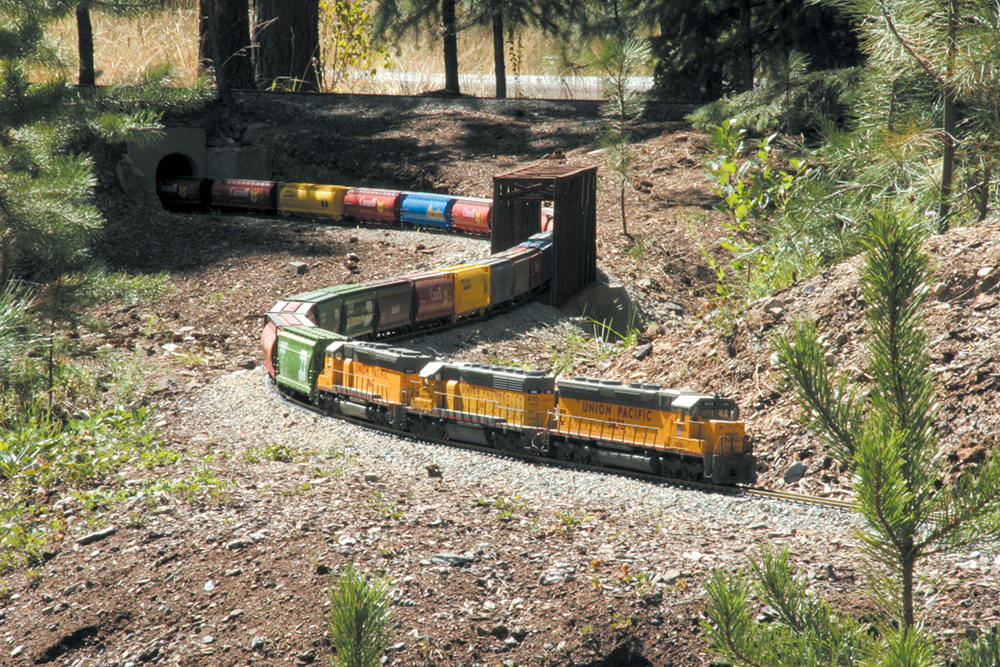 Model freight train on a curve