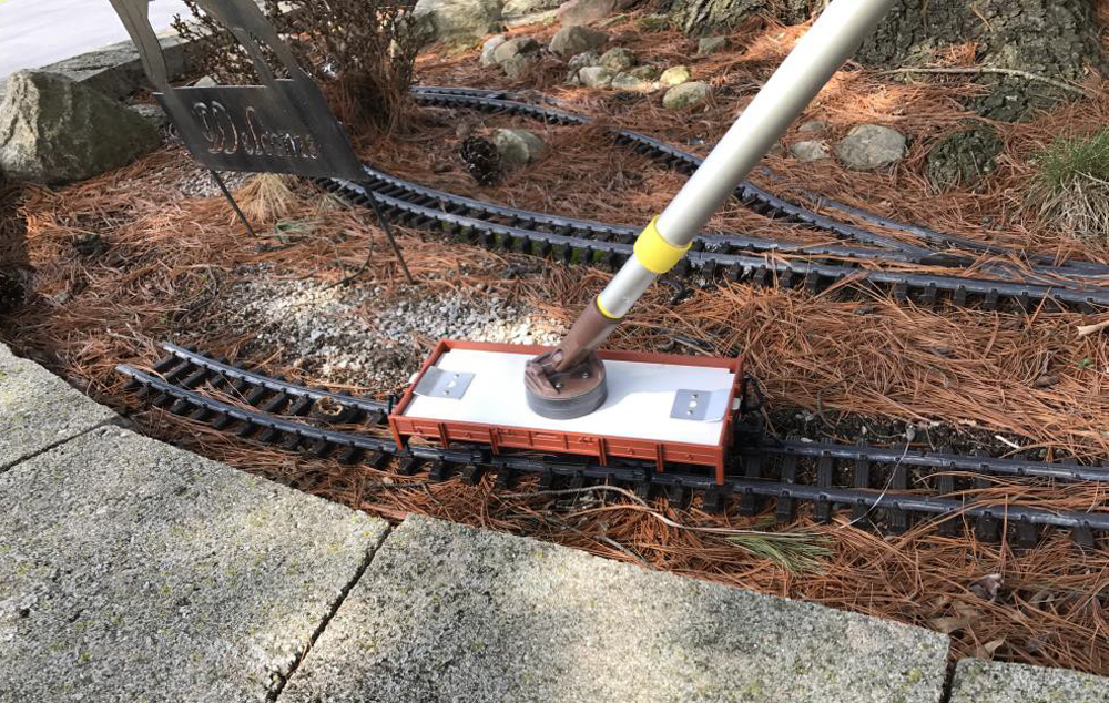 A track cleaner on a pole