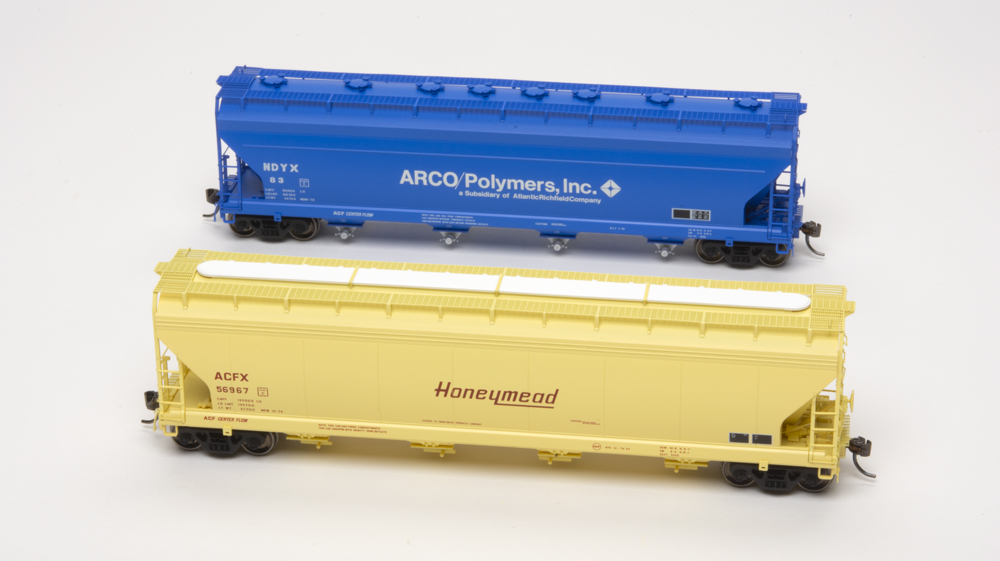 American Car & Foundry Honeymead and Arco Polymers 5,250-cubic-foot-capacity four-bay covered hoppers.