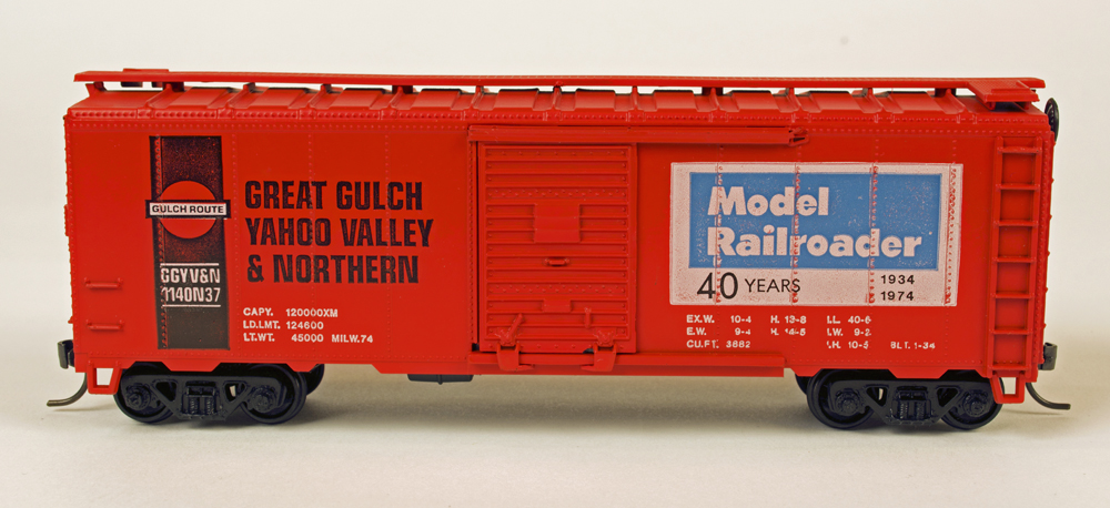 Athearn HO scale 40-foot boxcar kit painted orange and black and lettered for Model Railroader and the Great Gulch, Yahoo Valley & Northern.