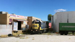 Locomotive next to two industries