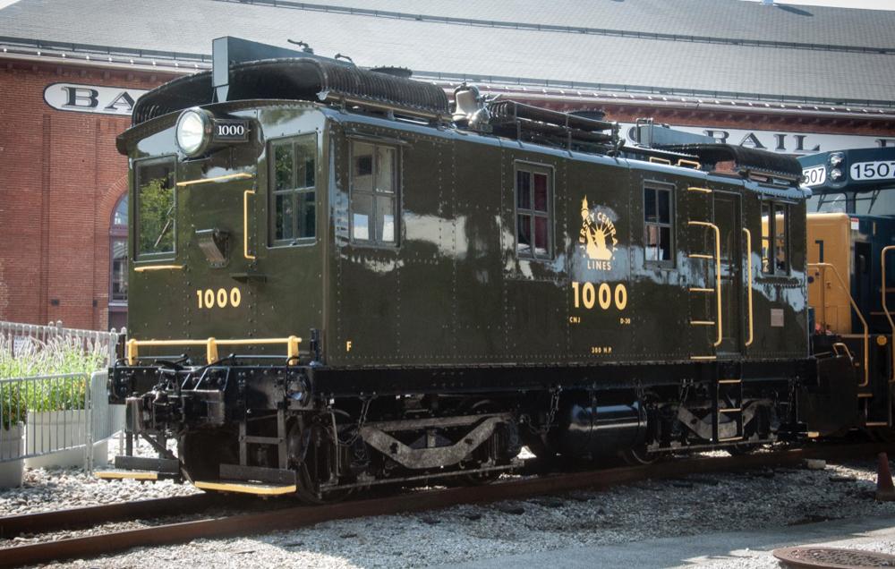 Olive green boxcab locomotive