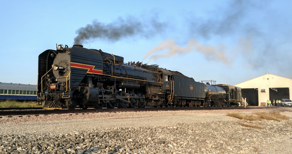 Steam locomotive leaves shop building