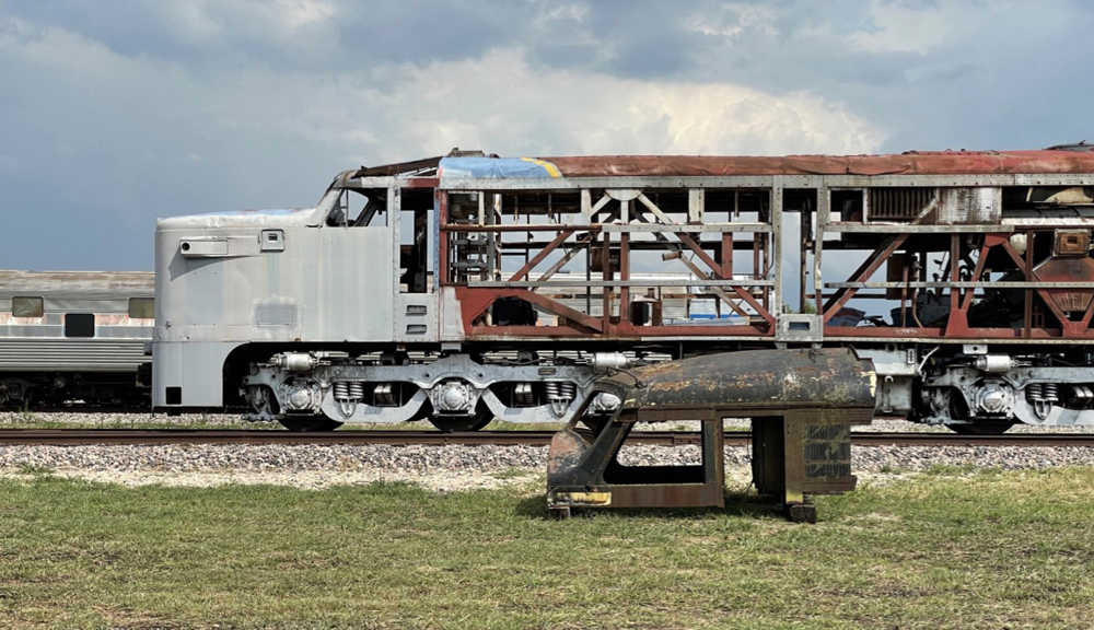 Nose and frame of locomotive with roof section in foreground