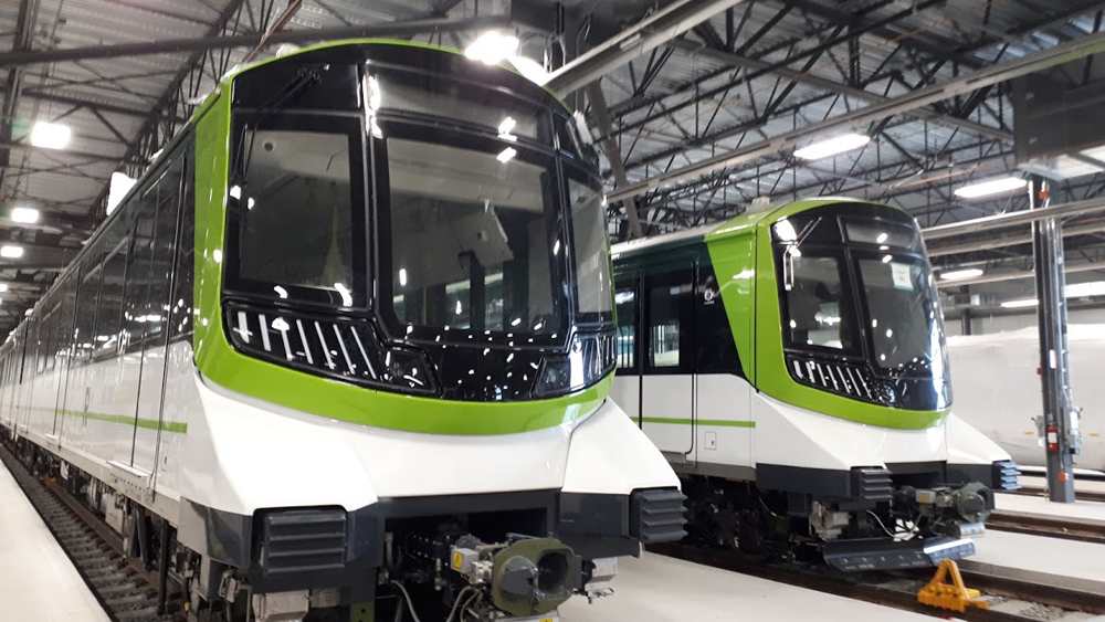 Green and white light rail trainsets