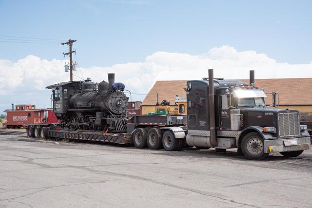 Steam locomotive on truck trailer