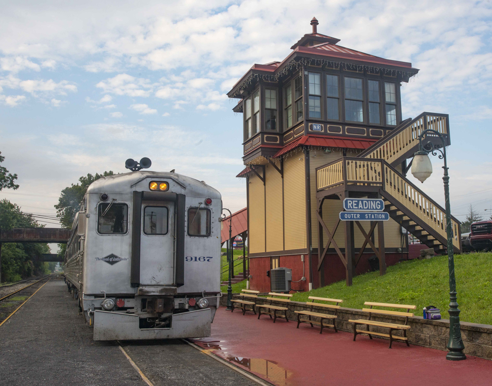 Stainless steel railcar at ornate station
