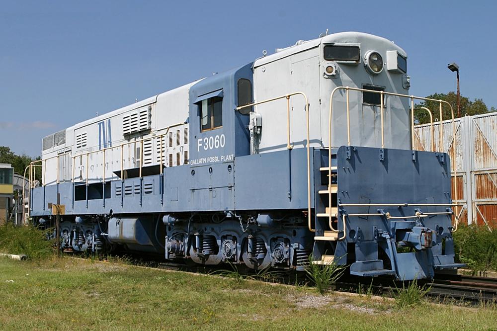 Light blue and white diesel locomotive