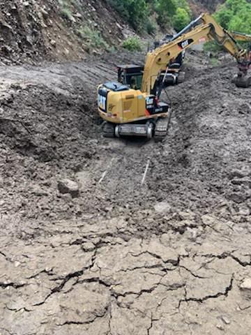 Heavy machinery working in mudslide