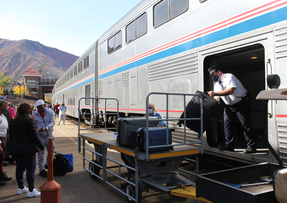 Man unloads luggage from Superliner car