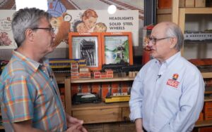 John Truckenbrod and Roger Carp with vintage Lionel blister packaging.