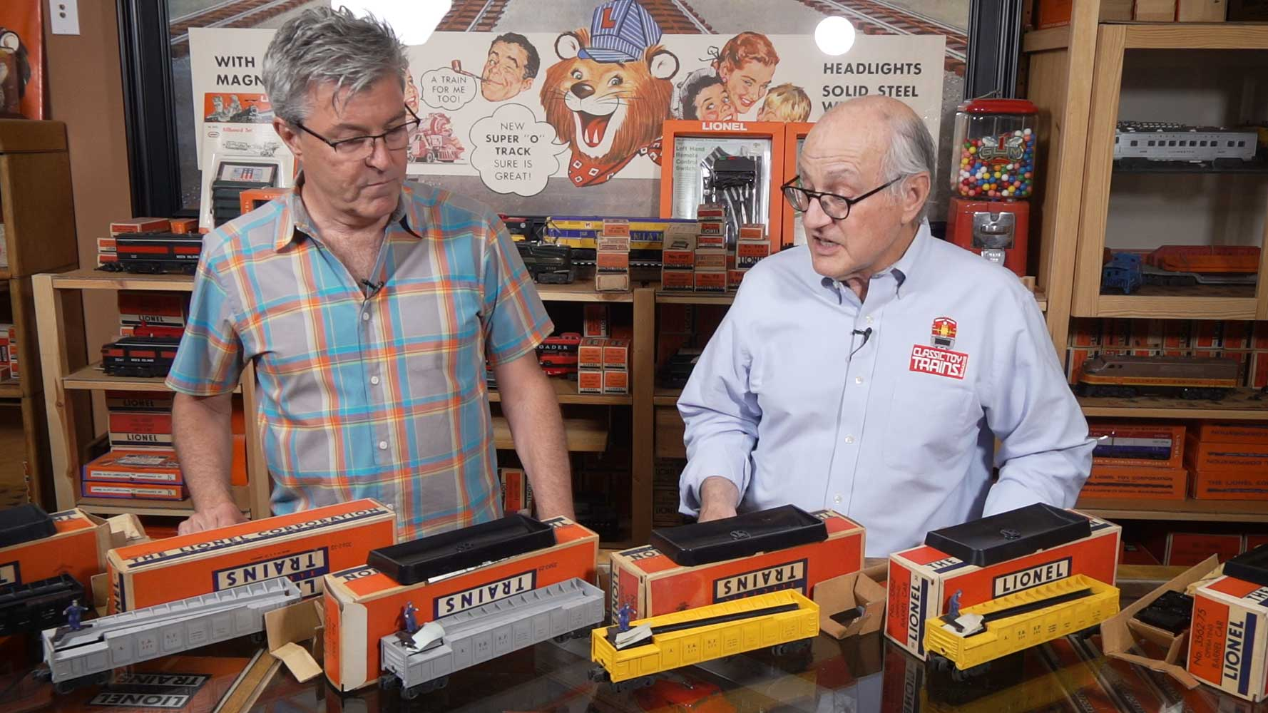 John Truckenbrod and Roger Carp display a collection of Lionel barrel cars.