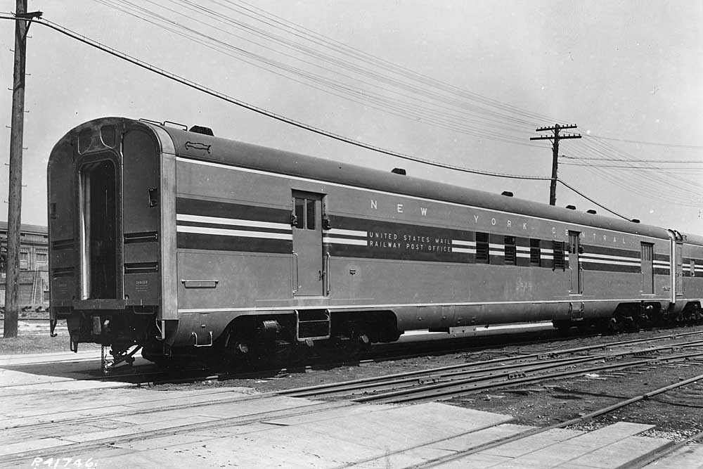 Three-quarter view of railroad passenger car with side loading doors