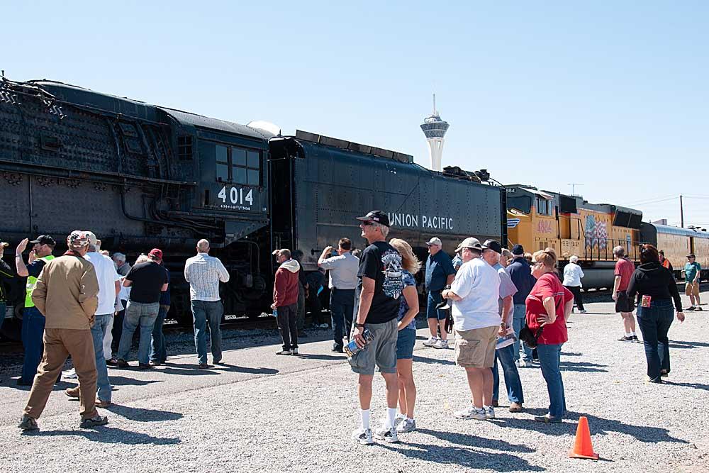 People look at steam locomotive on display