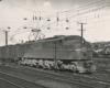 Black-and-white three-quarter-angle photo of streamlined electric locomotive.