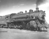 Black-and-white right-side photo of 4-6-2 steam locomotive