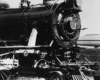 Black-and-white photo of front portion of 4-6-2 steam locomotive